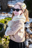 Portrait of little girl standing in winter park Royalty Free Stock Photos