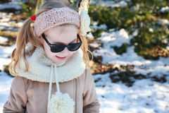 Portrait of little girl standing in winter park Royalty Free Stock Photography