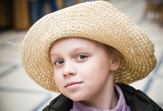 Portrait of a little girl with straw hat Stock Image