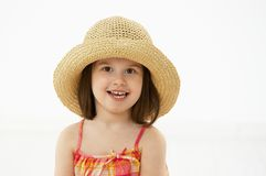 Portrait of little girl in summer straw Stock Image
