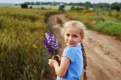 Portrait of a little girl on a summer walk in the field stock photo