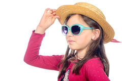 Portrait of a little girl with sunglasses and hat Royalty Free Stock Photo