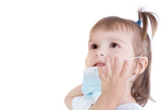 Portrait of little girl with surgical face mask Royalty Free Stock Images