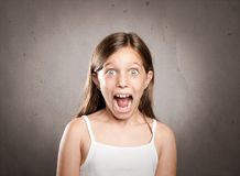 Portrait of little girl with surprise expression Stock Photo