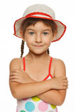 Portrait of little girl in swimsuit and hat Stock Photos