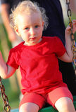 Portrait of a little girl on a swing. Two year old girl on a swing Stock Photos