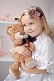 Portrait of little girl and Teddy Stock Photography