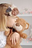 Portrait of little girl and Teddy Stock Image