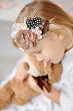 Portrait of little girl and Teddy Stock Photos