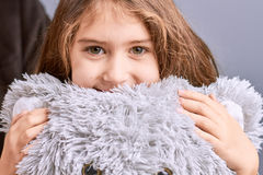 Portrait of little girl with teddy bear. Stock Photo
