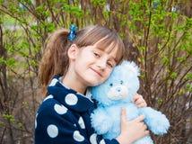 Portrait of a little girl with a teddy bear Royalty Free Stock Photos
