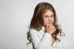 Portrait of little girl thinking, over a gray Stock Photography