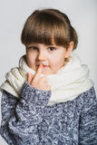 Portrait of little girl thinking, over a gray Stock Photo