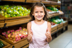Portrait of little girl with thumps up Stock Images