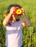 Portrait of the little girl with toy camera Stock Photos