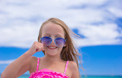 Portrait of little girl at tropical beach during Stock Images