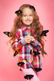 Portrait of a little girl with tropical butterflies. Stock Photography