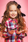 Portrait of a little girl with tropical butterflies. Royalty Free Stock Photo