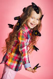 Portrait of a little girl with tropical butterflies. Royalty Free Stock Images