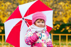 Portrait of a little girl with an umbrella Stock Photo
