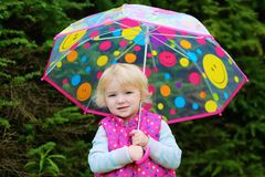Portrait of little girl with umbrella Royalty Free Stock Images