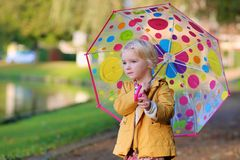 Portrait of little girl with umbrella Stock Photo