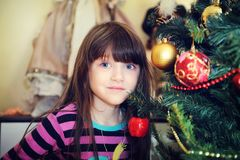 Portrait of little girl under Christmas tree Royalty Free Stock Photo