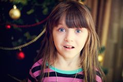 Portrait of little girl under Christmas tree Stock Photography
