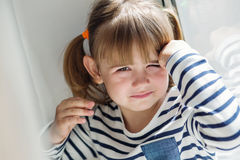 Portrait of a little girl upset Stock Photo
