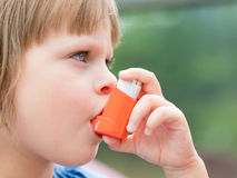 Portrait of little girl using asthma inhaler outdoors. Portrait of little girl child using asthma inhaler outdoors Royalty Free Stock Photo