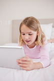 Portrait of a little girl using a tablet computer Royalty Free Stock Images