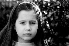 Portrait of a little girl very serious Royalty Free Stock Photos