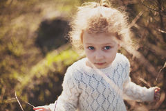 Portrait of a little girl walking in the field Royalty Free Stock Photography