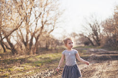 Portrait of a little girl walking in the field Royalty Free Stock Photos