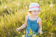 Portrait of a little girl walking in the field Royalty Free Stock Photo