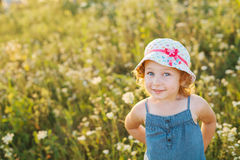 Portrait of a little girl walking in the field Stock Photos