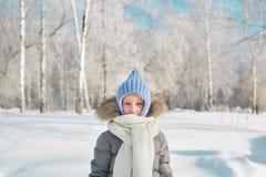 Portrait of little girl in warm wear in outdoors in winter Stock Images