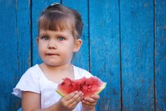 Portrait of a little girl with watermelon royalty free stock photos