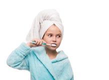 Portrait of little girl wearing bathrobe with towel on head brus Stock Image