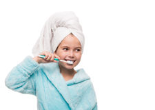 Portrait of little girl wearing bathrobe with towel on head brus Royalty Free Stock Photos