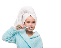 Portrait of little girl wearing bathrobe with towel on head brus Stock Photos