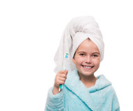 Portrait of little girl wearing bathrobe with towel on head with Royalty Free Stock Photography