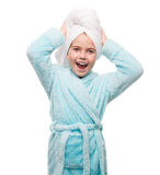 Portrait of little girl wearing bathrobe with towel on head Stock Photo