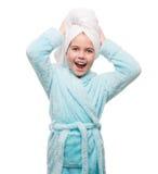 Portrait of little girl wearing bathrobe with towel on head Stock Photo