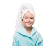 Portrait of little girl wearing bathrobe with towel on head Stock Image