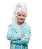 Portrait of little girl wearing bathrobe with towel on head Royalty Free Stock Photo