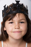 Portrait of little girl wearing black crown Royalty Free Stock Photo