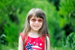 Portrait of little girl wearing red dress stock images