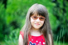 Portrait of little girl wearing red dress Royalty Free Stock Photo