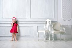 Portrait of a little girl wearing a santa hat stock images